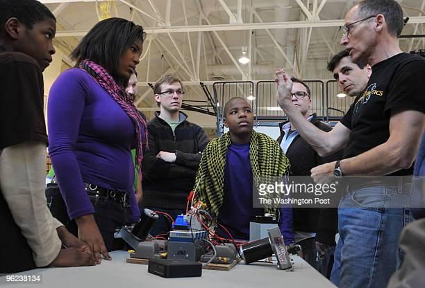 From left to right Ronovan Johnson Diana Webster Kris Comeforo teacher Tevin Johnson Michael Nagao and Jordan Snyder listen to robotics mentor Jerry...