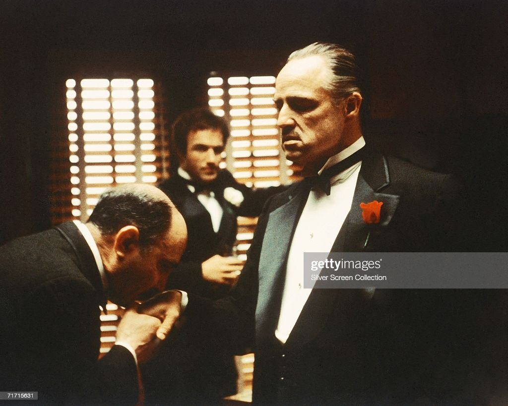 From left to right, Salvatore Corsitto as Bonasera, James Caan as Santino 'Sonny' Corleone and Marlon Brando (1924 - 2004) as Don Vito Corleone in 'The Godfather', 1972. Bonasera asks Don Corleone to avenge the brutal rape of his daughter.