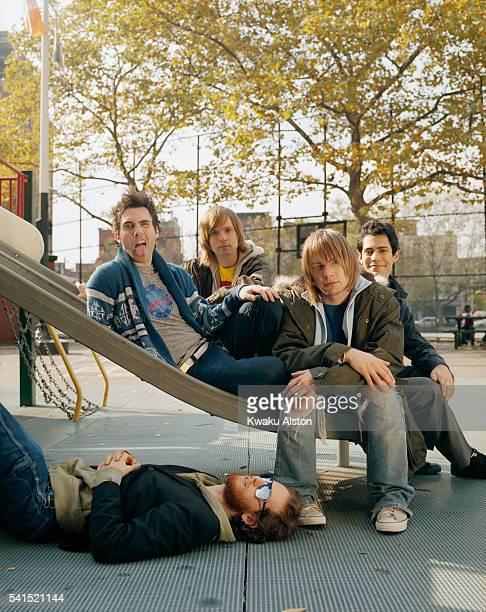 Singer and guitarist Adam Levine, guitarist James Valentine, bassist Mickey Madden, drummer Ryan Dusick, and keyboardist Jesse Carmichael (front, on ground).