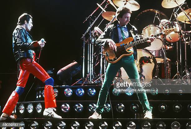 From left to right singer Freddie Mercury and musician John Deacon of British rock band Queen in concert 1980