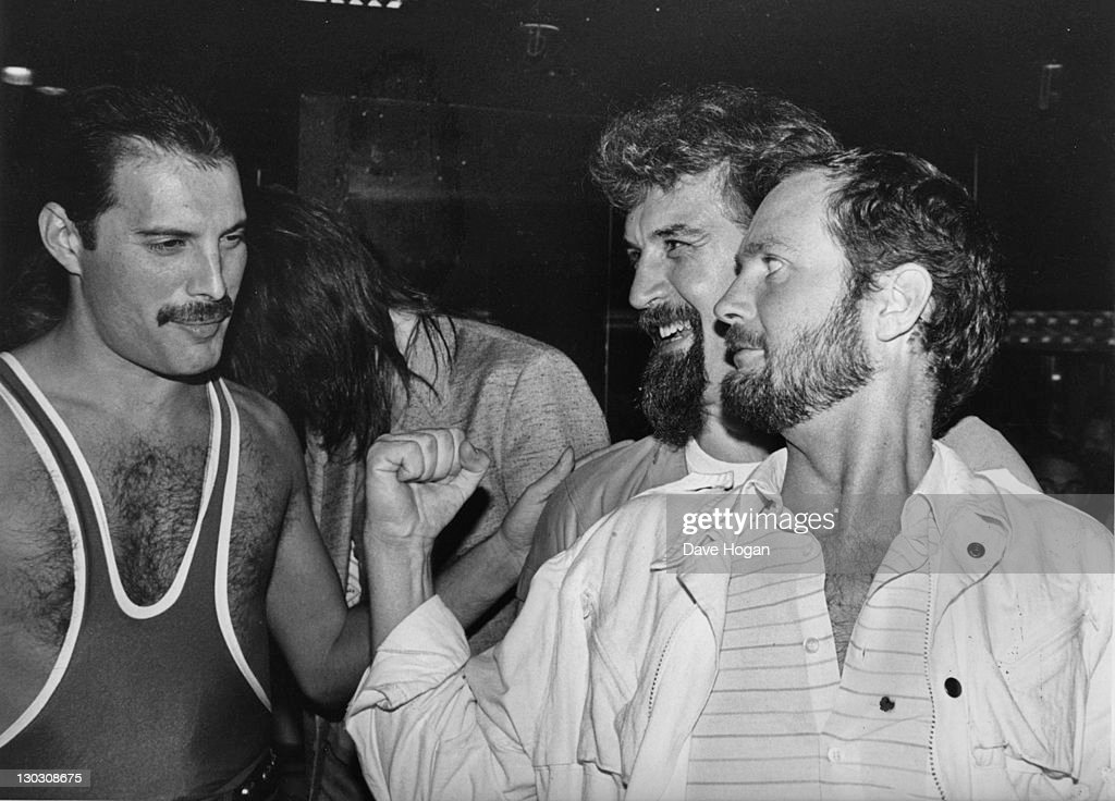 From left to right singer Freddie Mercury of British rock band Queen with comedian Billy Connolly and DJ Kenny Everett during Mercury's 38th birthday...
