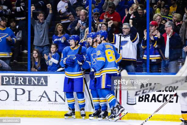From left to right St Louis Blues Ivan Barbashev Joel Edmundson and Zach Sanford celebrate a goal by Joel Edmundson during the third period of an NHL...
