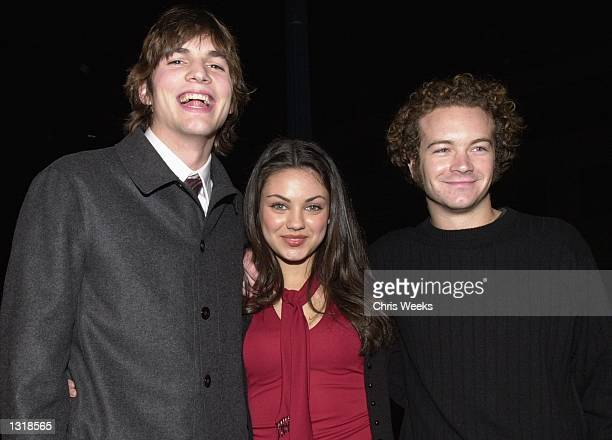 From left to right 'That 70''s Show' cast members Ashton Kutcher Mila Kunis and Danny Masterson arrive at the premiere of USA Films'' 'Traffic'...