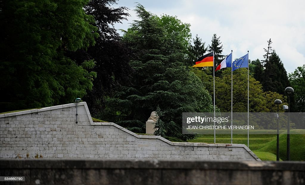 the German, French and European Union flags are hoisted side-by-side on May 27, 2016 in Verdun, eastern France. VERHAEGEN