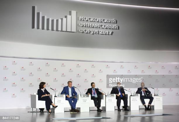 From left to right Torrey ClarkShirnina editor at Bloomberg News Herman Gref chief executive officer of Sberbank of Russia PJSC Vitor Gaspar director...