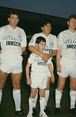 From left to right Tottenham Hotspur player Gary Mabbutt Argentine footballer Diego Maradona and English footballer Clive Allen with a young Pablo...