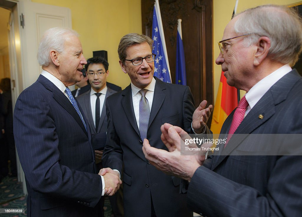 U.S. Vice President Joe Biden, German Economy Minister and Vice Chancellor <a gi-track='captionPersonalityLinkClicked' href=/galleries/search?phrase=Philipp+Roesler&family=editorial&specificpeople=4838791 ng-click='$event.stopPropagation()'>Philipp Roesler</a>, German Foreign Minister <a gi-track='captionPersonalityLinkClicked' href=/galleries/search?phrase=Guido+Westerwelle&family=editorial&specificpeople=208748 ng-click='$event.stopPropagation()'>Guido Westerwelle</a> and U.S. Senator <a gi-track='captionPersonalityLinkClicked' href=/galleries/search?phrase=Sam+Nunn&family=editorial&specificpeople=209203 ng-click='$event.stopPropagation()'>Sam Nunn</a> talking during the Reception on the occasion of the award of the large Bundesverdienstkreuz with Star of the Federal Republic of Germany to U.S. Senator <a gi-track='captionPersonalityLinkClicked' href=/galleries/search?phrase=Sam+Nunn&family=editorial&specificpeople=209203 ng-click='$event.stopPropagation()'>Sam Nunn</a> on day 1 of the 49th Munich Security Conference at Hotel Bayerischer Hof on February 1, 2013 in Munich, Germany. The Munich Security Conference brings together senior figures from around the world to engage in an intensive debate on current and future security challenges and remains the most important independent forum for the exchange of views by international security policy decision-makers.