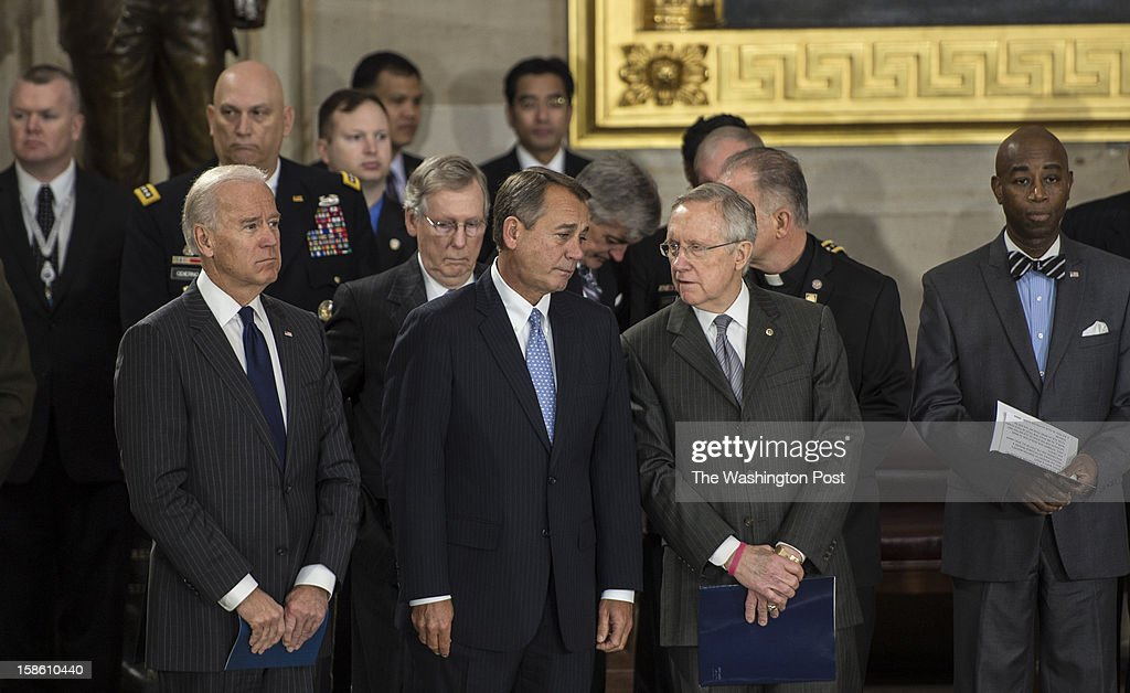 DECEMBER 20 -- From left to right, Vice-President Joe Biden, Mitch McConnell, (R-KY) Speaker of the House John Boehner and Sen. Harry Reid (d0NV) attend a funeral service for Senator Daniel Inouye (D-HI) at the Capitol Rotunda on Capitol Hill in Washington, D.C., on Thursday, December 20, 2012.