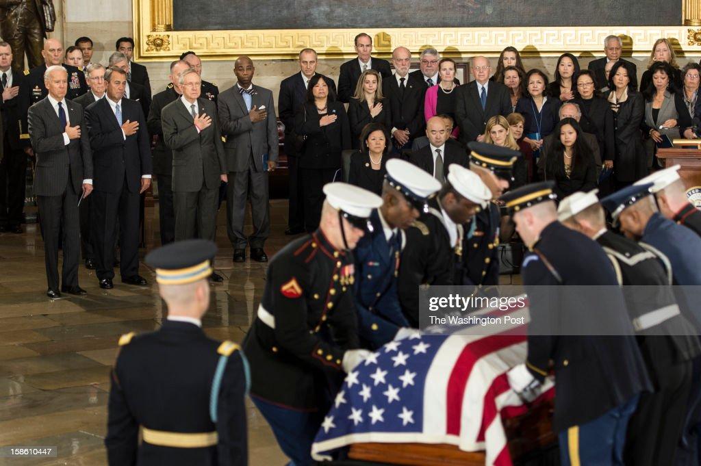 DECEMBER 20 -- From left to right, Vice-President Joe Biden, Speaker of the House John Boehner and Sen. Harry Reid (D-NV) watch as Senator Daniel Inouye's casket is brought into the Capitol Rotunda on Capitol Hill in Washington, D.C., on Thursday, December 20, 2012.