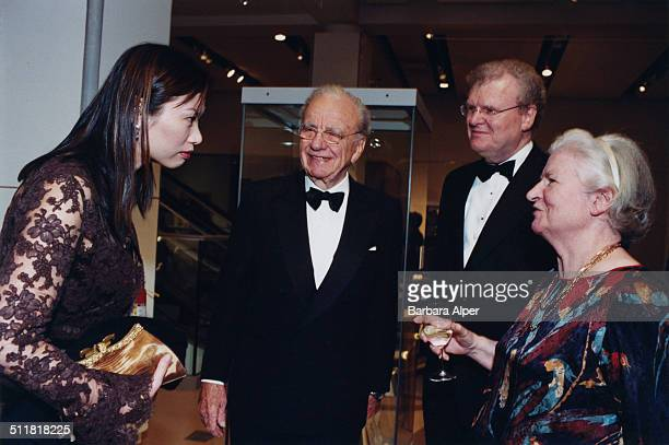 From left to right Wendi Murdoch Rupert Murdoch Howard Stringer and novelist P D James at a Sotheby's fundraiser in New York City 28th October 2002