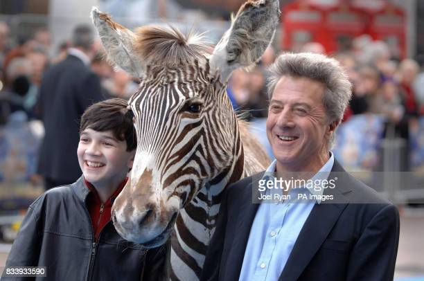 Zachary Mills and Dustin Hoffman stand next to a figure of a donkey as they arrive for the UK film premiere of Mr Magorium's Wonder Emporium at the...