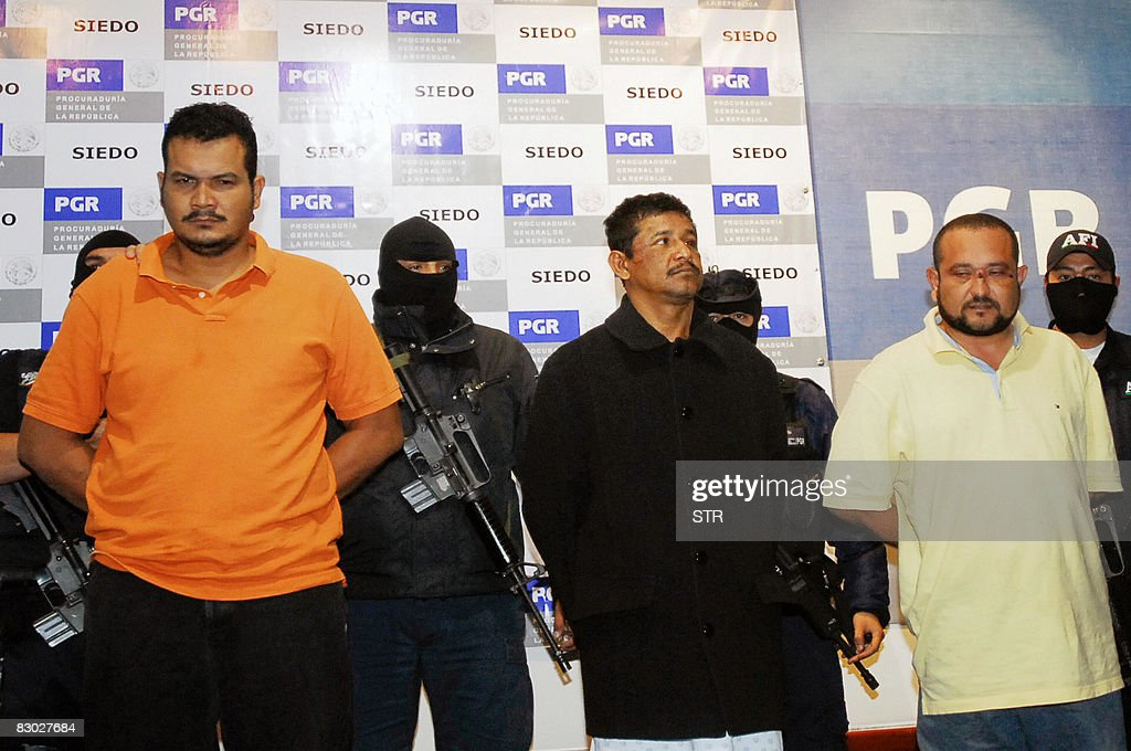 Julio Cesar Mondragon Mendoza, Juan Carlos Castro Galeana y Alfredo Rosas Elicea, members of a group of hitmen called the 'Zetas' are shown to the press at the General Attorney's office in Mexico City, on September 26, 2008. The three gangsters confessed that they are the authors of a grenade attack that killed eight people during the celebration of Independence Day in Morelia, western Mexico. AFP PHOTO/STR