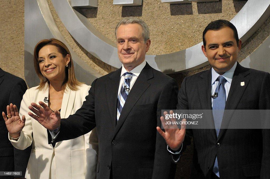 the three presidential precandidates of the National Action Party Josefina Vazquez Mota Santiago Creel and Ernesto Cordero wave to photographers...