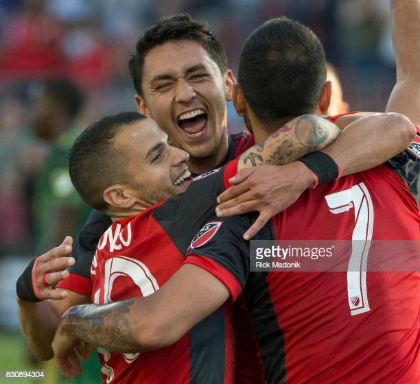 From left Toronto FC forward Sebastian Giovinco Toronto FC midfielder Marco Delgado and Toronto FC midfielder Victor Vazquez celebrate Vazquez's goal...