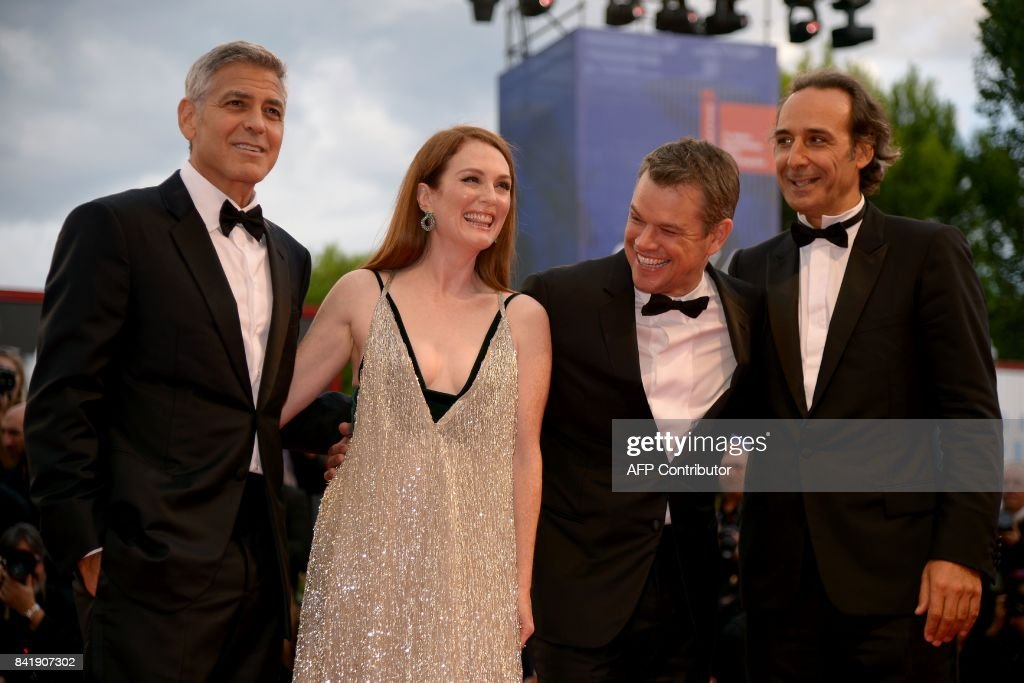 US actor and director George Clooney, US actess Julianne Moore, US actor Matt Damon and French composer Alexandre Desplat attend the premiere of the movie 'Suburbicon' presented out of competition at the 74th Venice Film Festival on September 2, 2017 at Venice Lido. / AFP PHOTO / Filippo MONTEFORTE