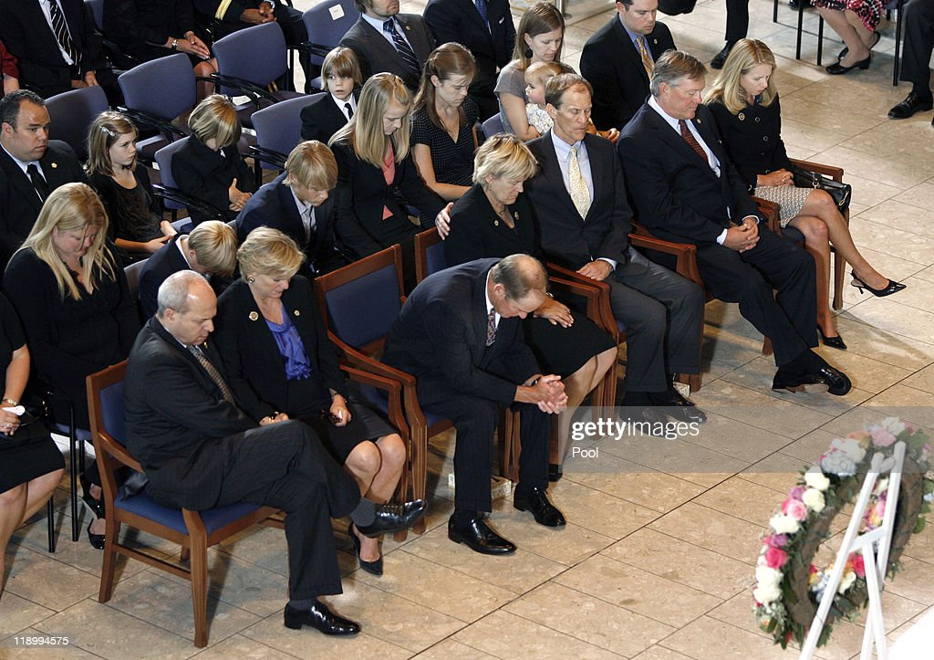 From left Vaden Bales Susan Ford Bales Steve Ford Julian and Jack Ford Mike and Gayle Ford and other family members pray at a service for former...