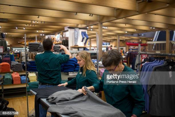 From left Van Perry Michelle Bolduc and Susan Anderson fold clothing together at the flagship LL Bean store LL Bean is offering early retirement...