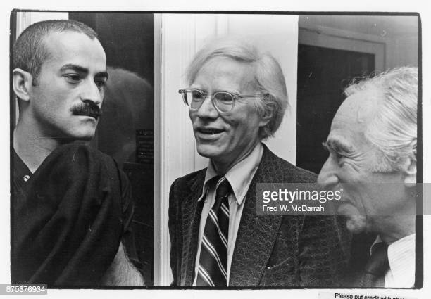 From left Venezuelanborn artist Victor Hugo American Pop artist Andy Warhol and American art dealer Leo Castelli talk together at Castelli's gallery...