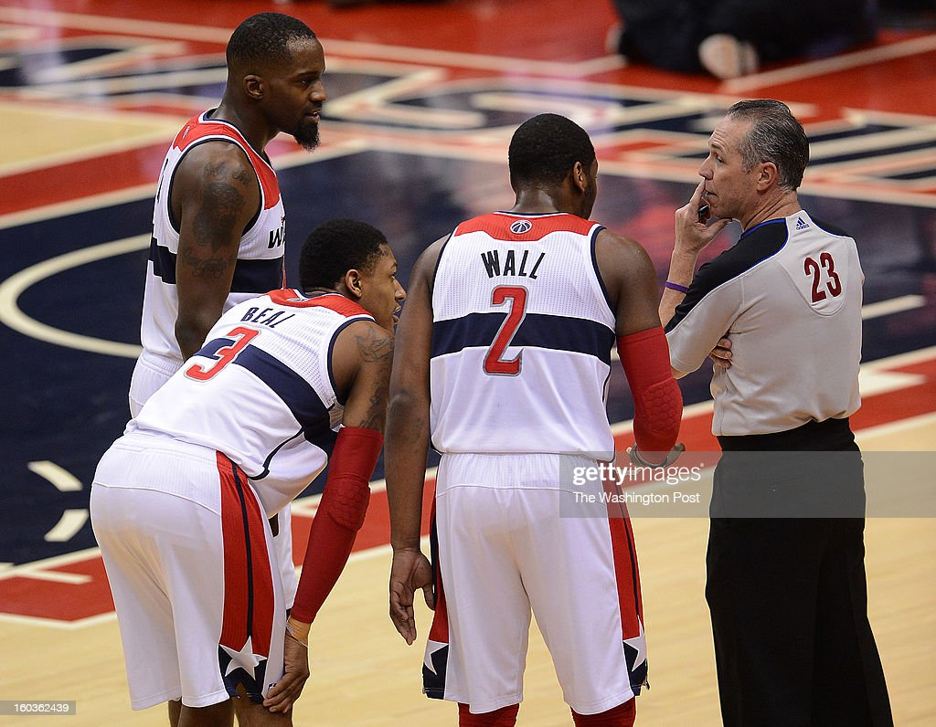 From left, Washington Wizards small forward Martell Webster (9), Washington Wizards shooting guard Bradley Beal (3), and Washington Wizards point guard John Wall (2) talk with referee Jason Phillips after Wall was charged with a technical foul during first half of the game at the Verizon Center on Monday, January 28, 2013.