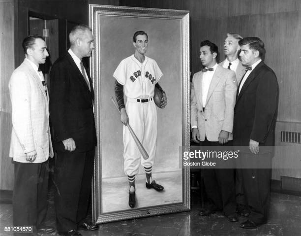 From left William G Purdi Richard H O'Connell Michael N Klironomis Charles C Linberg and Michael N Purdis view a portrait of Harry Agganis at Fenway...