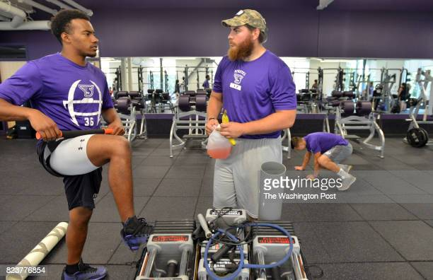 From left Yaniv Kovalski of Jerusalem Israel talks with r linebacker Vandy Hall of Ewing NJ before a workout with teammates in the athletic gym at...