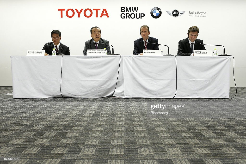 From left, Yasumori Ihara, director and senior managing officer of Toyota Motor Corp., Takeshi Uchiyamada, vice chairman of Toyota Motor Corp., Herbert Diess, development chief of Bayerische Motoren Werke AG (BMW), and Klaus Froehlich, senior vice president of BMW Group, attend a joint news conference in Nagoya, Aichi Prefecture, Japan, on Thursday, Jan. 24, 2013. Toyota, the world's biggest maker of gasoline-electric hybrid vehicles, signed a binding agreement with BMW to jointly develop fuel-cell systems for cars. Photographer: Kiyoshi Ota/Bloomberg via Getty Images