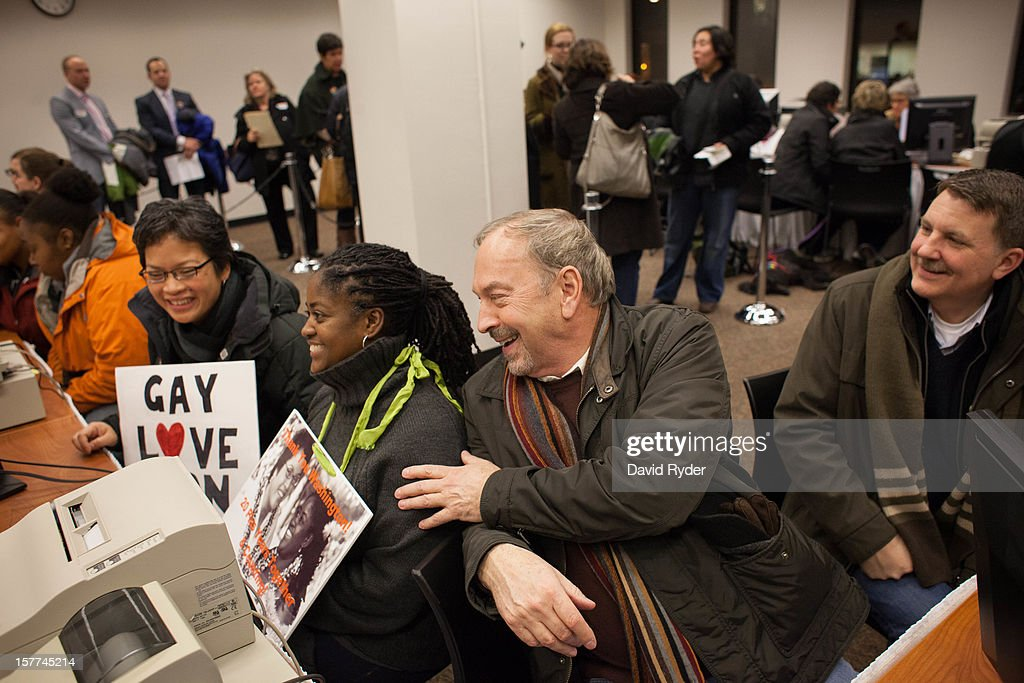 From left, Zone Montoya, Tasha Bassett, Nick Chicka, and Jeff Lovern share a laugh as they receive their marriage licenses at the King County Recorder's Office just after 3:00 a.m. on December 6, 2012 in Seattle, Washington. Chicka and Lovern have been together for 37 years and will hold a ceremony this winter on their anniversary. The Recorder's Office opened at 12:01 a.m. to begin issuing marriage licenses to same-sex couples for the first time after Washington voters chose to legalize gay marriage in November's election.