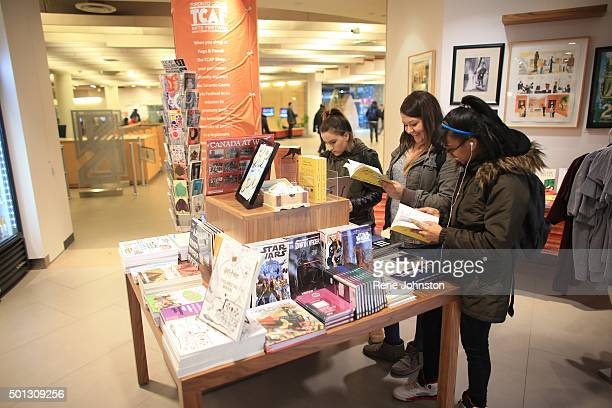 TORONTO ONTARIO DECEMBER 8 2015 From let to right Nicole Milo Gabby Scala and Alexis Walker check out the books on display It is the first...