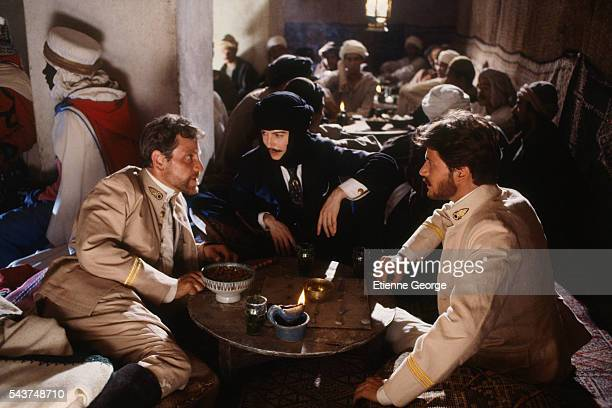 Actors Tcheky Karyo Anna Galiena dressed as a man and Christopher Thompson on the set of Bob Swaim's film 'L'Atlantide' based on French writer Pierre...
