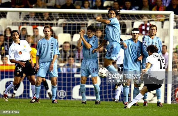 From LR Ajax players in blue Andy van der Meyde Jari Litmanen Mido Chivu and Andre Bergdoelmo try to block a freekick of Valencia's Amedeo Carboni...