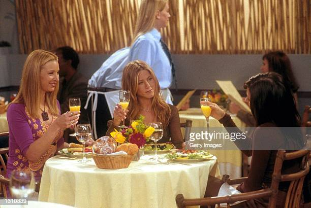 From lr Lisa Kudrow Jennifer Aniston and Courteney Cox act in a scene from 'Friends'