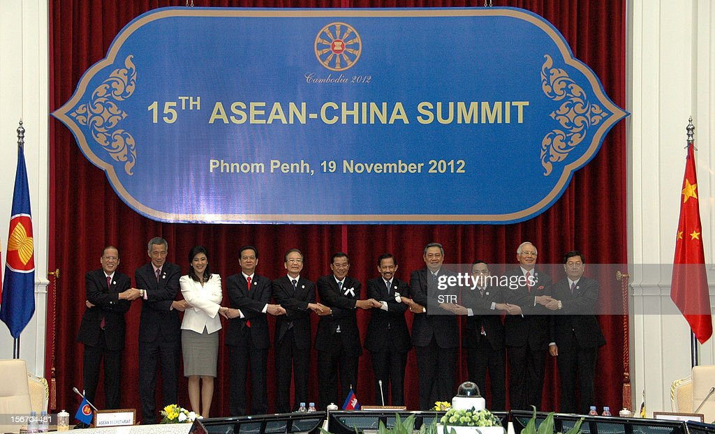 Philippine President Benigno Aquino, Singapore Prime Minister Lee Hsien Loong, Thai Prime Minister Yingluck Shinawatra, Vietnamese Prime Minister Nguyen Tan Dung, Chinese Premier Wen Jiabao, Cambodian Prime Minister Hun Sen, Brunei Sultan Hassanal Bolkiah, Indonesian President Susilo Bambang Yudhoyono, Laos Prime Minister Thongsing Thammavong, Malaysian Prime Minister Najib Razak and Myanmar Deputy Foreign Minister Kan Zaw pose for a family photo session during the Association of Southeast Asian Nations (ASEAN) and China summit 2012 at the Peace Palace in Phnom Penh on November 19, 2012. Chinese Prime Minister Wen Jiabao told Southeast Asian leaders on November 19, that negotiations to end territorial disputes in the South China Sea should only be held between claimant countries.