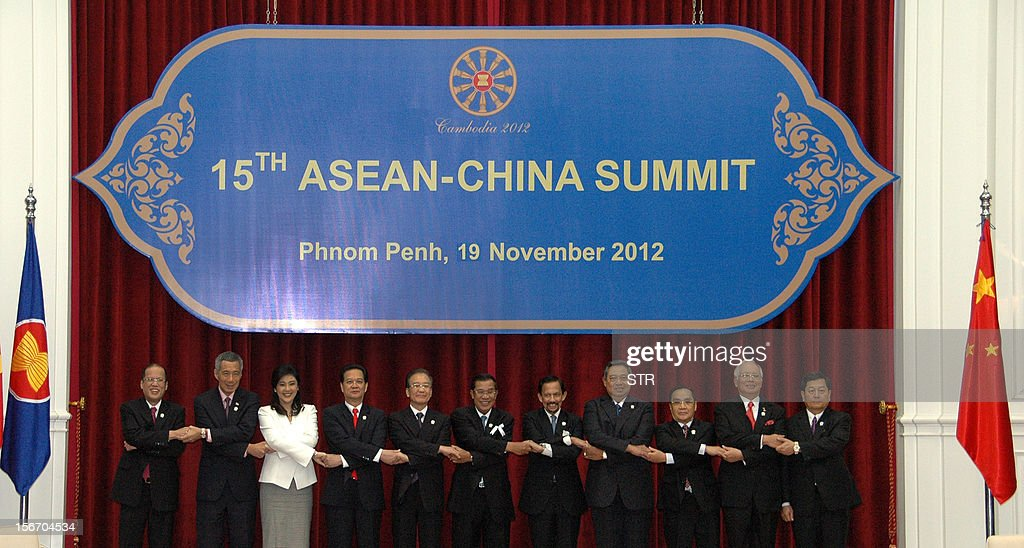 Philippine President Benigno Aquino, Singapore Prime Minister Lee Hsien Loong, Thai Prime Minister Yingluck Shinawatra, Vietnamese Prime Minister Nguyen Tan Dung, Chinese Premier Wen Jiabao, Cambodian Prime Minister Hun Sen, Brunei Sultan Hassanal Bolkiah, Indonesian President Susilo Bambang Yudhoyono, Laos Prime Minister Thongsing Thammavong, Malaysian Prime Minister Najib Razak and Myanmar Deputy Foreign Minister Kan Zaw pose for a family photo session during the Association of Southeast Asian Nations (ASEAN) and China summit 2012 at the Peace Palace in Phnom Penh on November 19, 2012. Chinese Prime Minister Wen Jiabao told Southeast Asian leaders onNovember 19, that negotiations to end territorial disputes in the South China Sea should only be held between claimant countries.