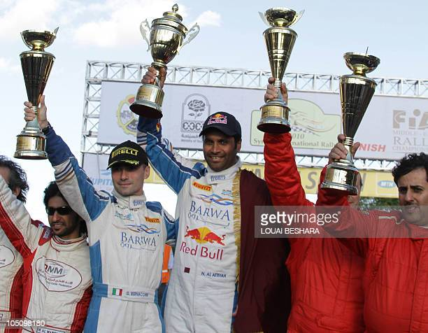 Third place Italian codrivers Nicola Arena and team mate Qatari driver Mesfer AlMerri first place winners Italian codrivers Giovanni Bernacchini and...