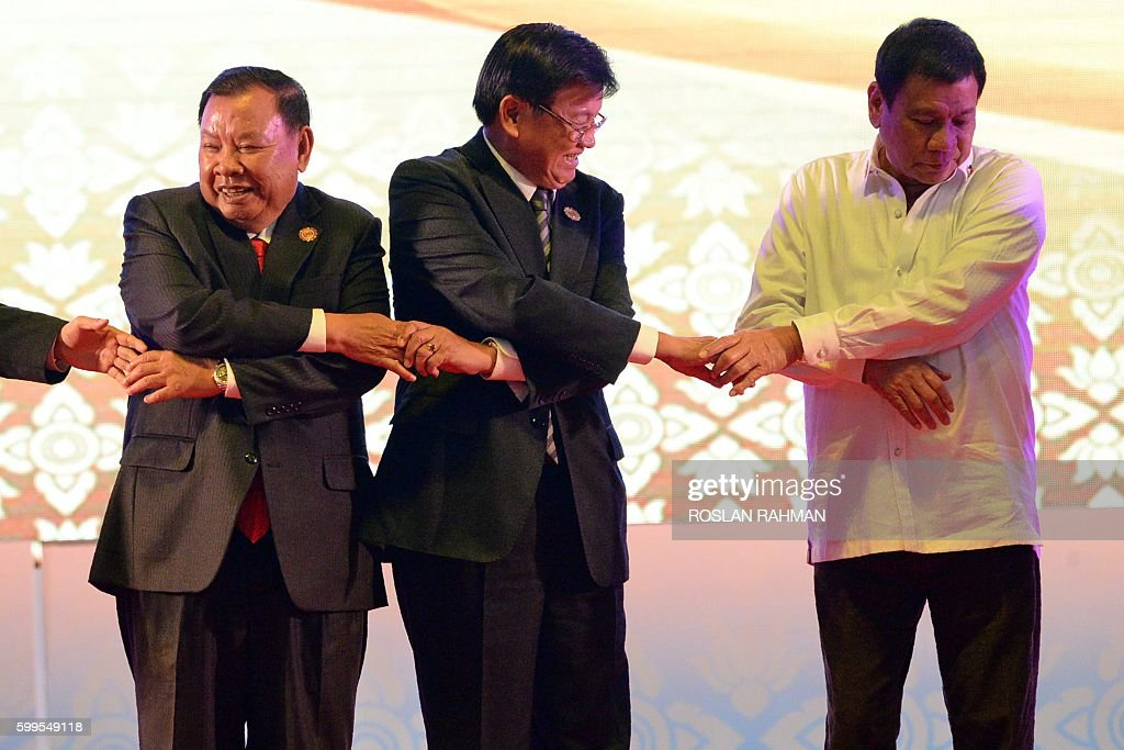 Vietnam's Prime Minister Nguyen Xuan Phuc, Laos Prime Minister Thongloun Sisoulith and Philippine President Rodrigo Duterte attend the opening of the Association of Southeast Asian Nations (ASEAN) Summit in Vientiane on September 6, 2016. The gathering will see the 10 ASEAN members meet by themselves, then with leaders from the US, Japan, South Korea and China. RAHMAN