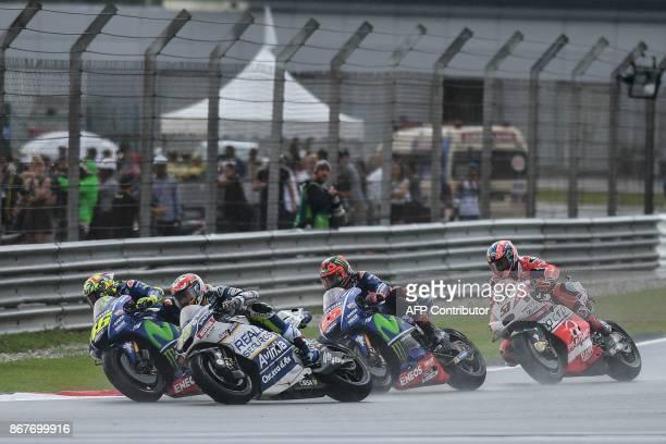 From Movistar Yamaha Italian rider Valentino Rossi Reale Avintia Racing's French rider Loris Baz Movistar Yamaha Spanish rider Maverick Vinales and...