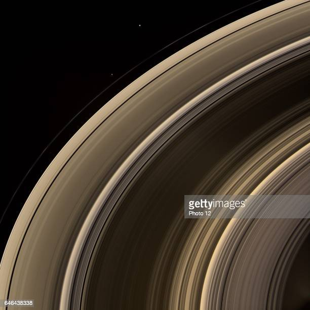 From on high the Cassini spacecraft spies a group of three ring moons in their travels around Saturn