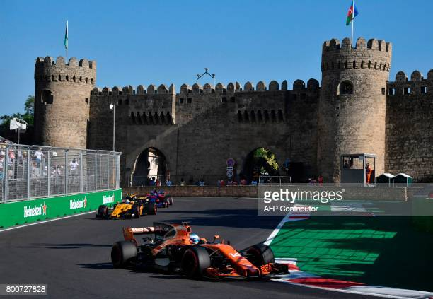 McLaren's Spanish driver Fernando Alonso Renault's British driver Jolyon Palmer and Torro Rosso's Spanish driver Carlos Sainz Jr steer their cars...