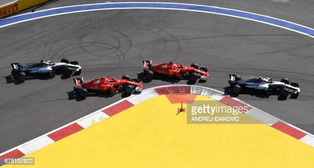 Mercedes' Finnish driver Valtteri Bottas Ferrari's German driver Sebastian Vettel Ferrari's Finnish driver Kimi Raikkonen and Mercedes' British...