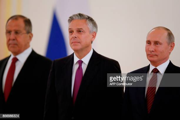 Russian President Vladimir Putin and US ambassador to Russia Jon Huntsman pose for pictures during a ceremony of receiving diplomatic credentials...