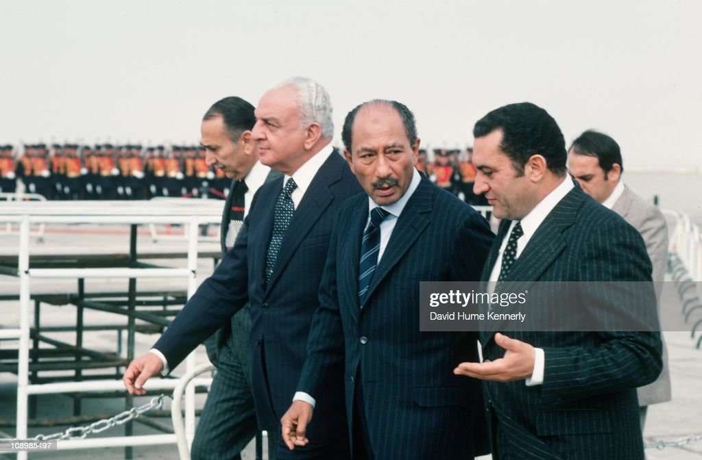 From right, Egypt's Vice-President <a gi-track='captionPersonalityLinkClicked' href=/galleries/search?phrase=Hosni+Mubarak&family=editorial&specificpeople=201752 ng-click='$event.stopPropagation()'>Hosni Mubarak</a> walks with Egyptian President Anwar al Sadat (1918 - 1981) at the Cairo airport, after returning from Israel, November 1977.