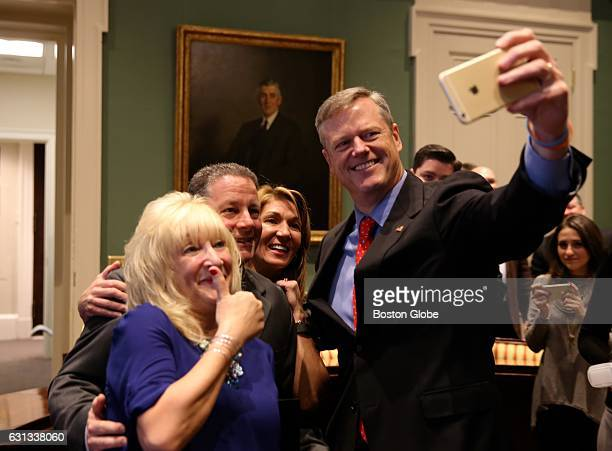 From right Massachusetts Governor Charlie Baker takes a selfie with Lieutenant Governor Karyn Polito Mark McNeill and McNeill's fiancee Julianne...