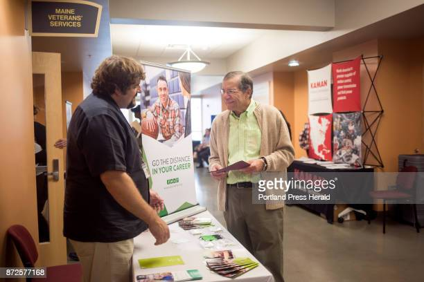 From right Michael Parsons a Vietnam veteran from Scarborough talks with Chris St Louis an HR recruiter with Spurwink during a job fair at the Maine...
