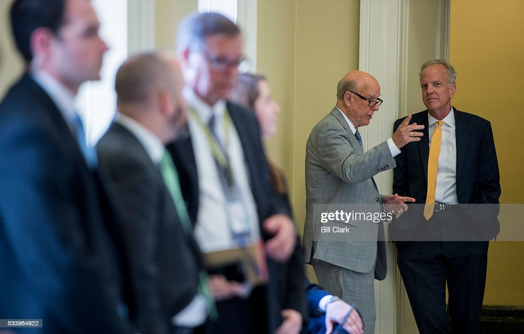 From right, Sen. Jerry Moran (R-KS) and Sen. Pat Roberts (R-KS) talk in the hallway outside of the Senate Republicans' policy lunch on Tuesday, May 24, 2016.