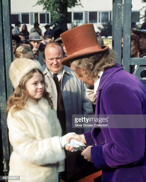 From right to left actors Gene Wilder as Willy Wonka Roy Kinnear as Mr Salt and Julie Dawn Cole as Veruca Salt in the film 'Willy Wonka the Chocolate...