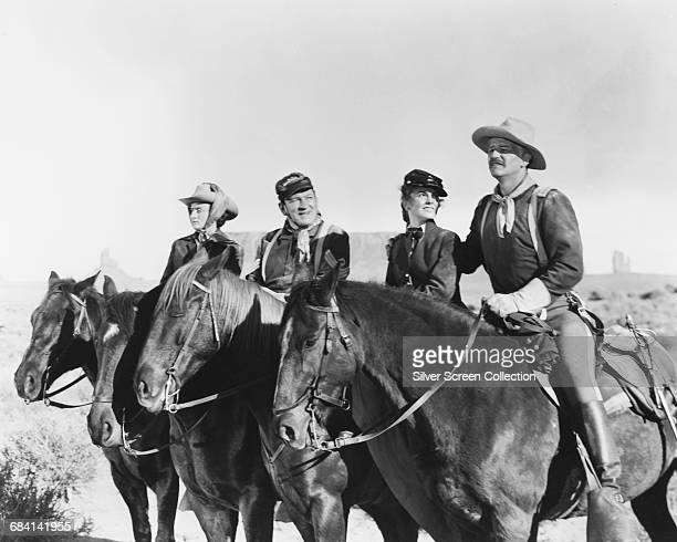 From right to left American actor John Wayne as Captain Nathan Cutting Brittles Joanne Dru as Olivia Dandridge Victor McLaglen as Top Sgt Quincannon...