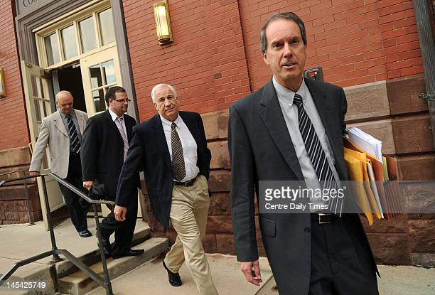 From right to left Attorney Joe Amendola Jerry Sandusky Attorney Karl Rominger and Centre County Sheriff Denny Nau exit the Centre County Courthouse...