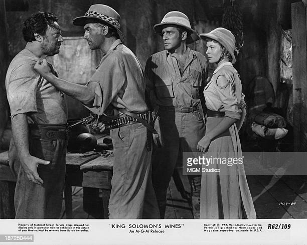 From right to left Deborah Kerr Richard Carlson and Stewart Granger confront another man in a scene from the film 'King Solomon's Mines' 1950