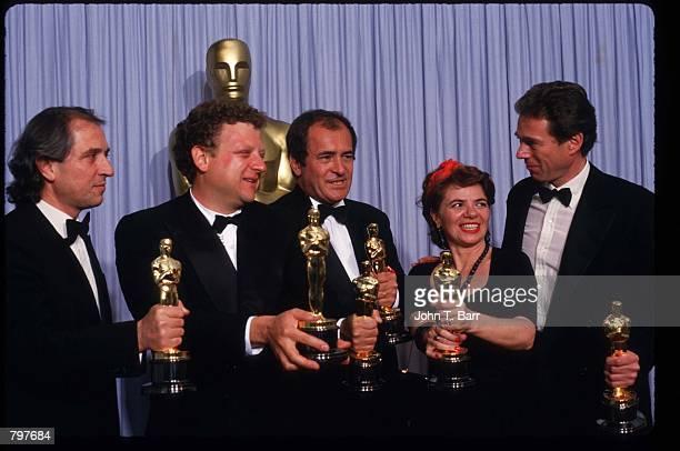 From right to left The creative team behind the Best Picture Oscar 'The Last Emperor' Mark Peploe Jeremy Thomas Bernardo Bertolucci Gabriella...