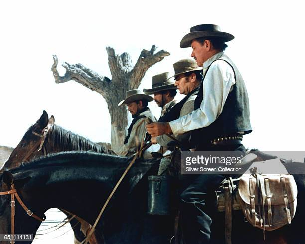 From right to left William Holden as Pike Bishop Ernest Borgnine as Dutch Engstrom Warren Oates as Lyle Gorch and Ben Johnson as Tector Gorch in the...